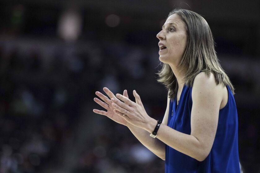 California head coach Lindsay Gottlieb raises her hands