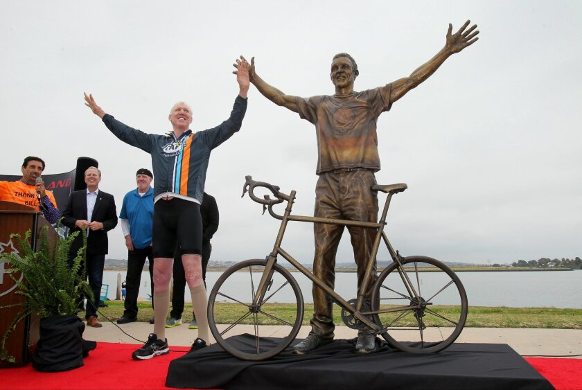 Bill Walton stands with the new bronze statue of himself during its unveiling event at Mission Bay's Ski Beach.