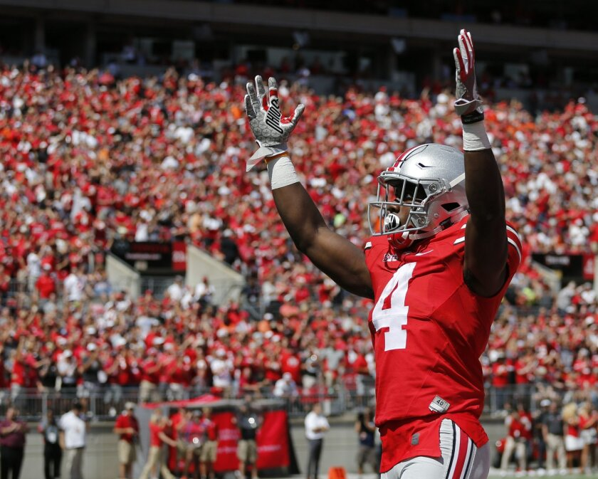 Ohio State running back Curtis Samuel celebrates his touchdown against Bowling Green during the first half of an NCAA college football game Saturday, Sept. 3, 2016, in Columbus, Ohio. (AP Photo/Jay LaPrete)