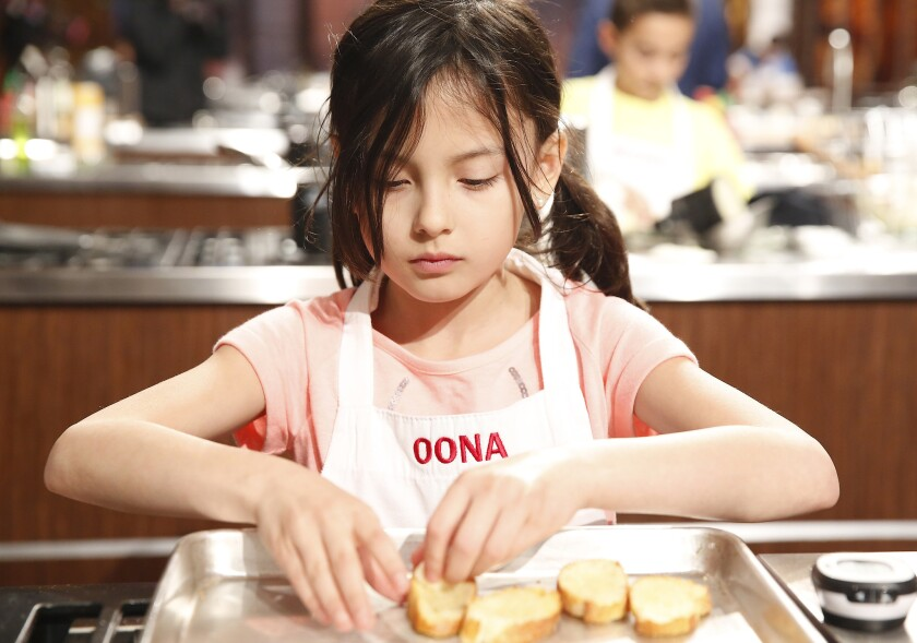 """Contestant Oona cooks for the gold in the new season of """"MasterChef Junior,"""" beginning Tuesday on Fox."""
