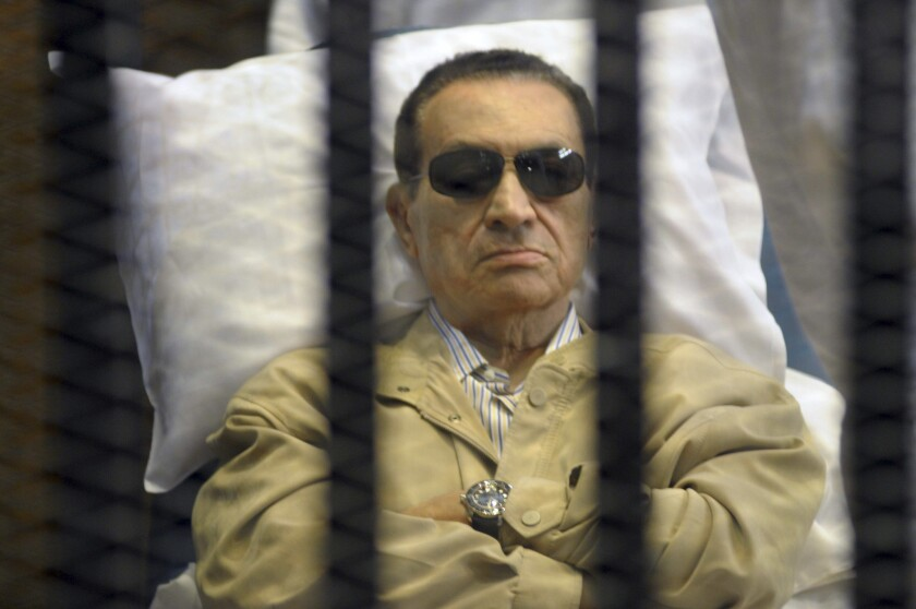 Former Egyptian President Hosni Mubarak attends his trial in a Cairo court on a stretcher.