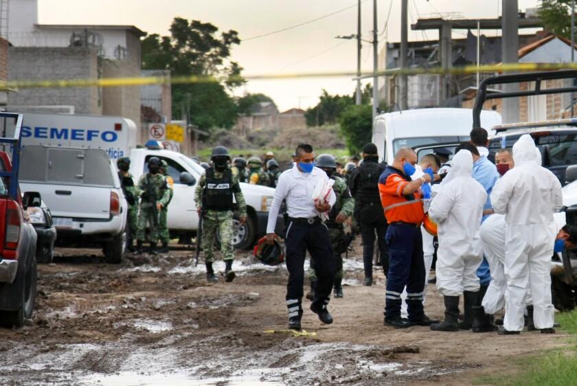 Forensic service personnel prepare to enter the drug rehabilitation center in Irapuato.