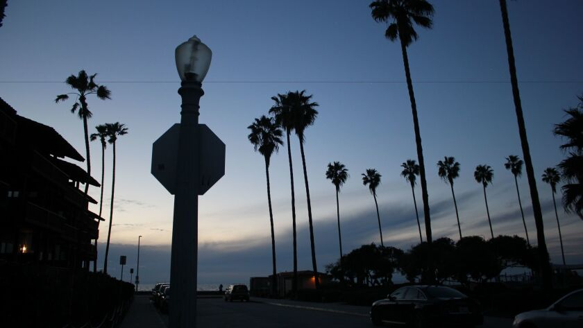 An acorn lamppost on Vallecitos Street stays off on Monday, March 20 as the night sets over La Jolla Shores.