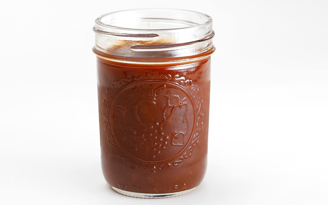 Cola is used as the sweetener in this whiskey-spiked barbecue sauce based on the ketchup-y sauces beloved in the Midwest.