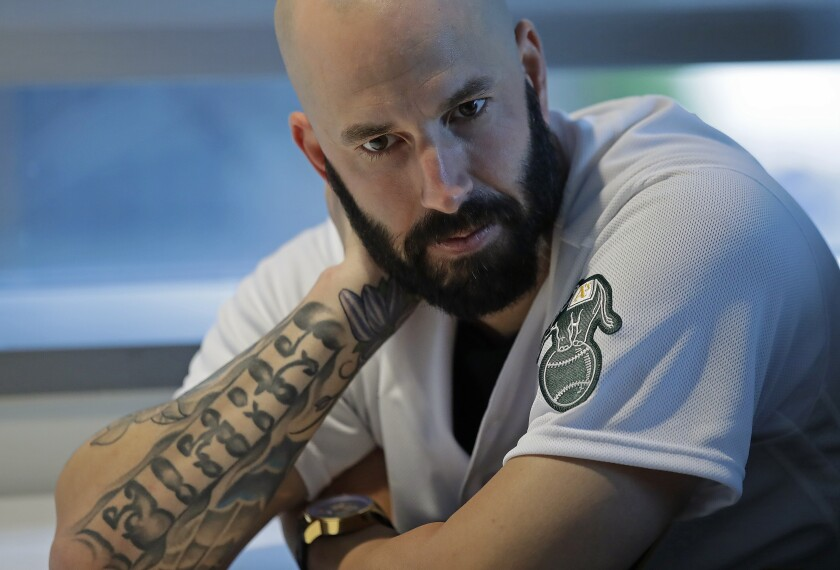 Oakland Athletics pitcher Mike Fiers ponders a question during an interview with the media on Friday, Jan. 24, 2020, in Oakland, Calif. Fiers, the Oakland pitcher and whistleblower in the Houston Astros sign-stealing scandal, appeared with teammates and manager Bob Melvin at team offices. Fiers has not spoken publicly about the sign stealing since the story was published in The Athletic in November. (AP Photo/Ben Margot)