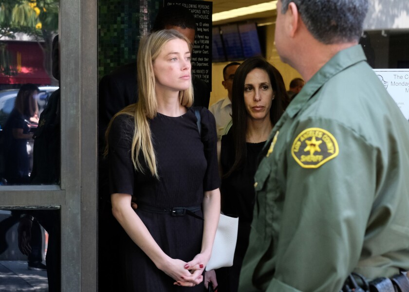Actress Amber Heard leaves Los Angeles Superior Court court on May 27 after giving a sworn declaration that her husband Johnny Depp threw her cellphone at her during a fight, striking her cheek and eye.