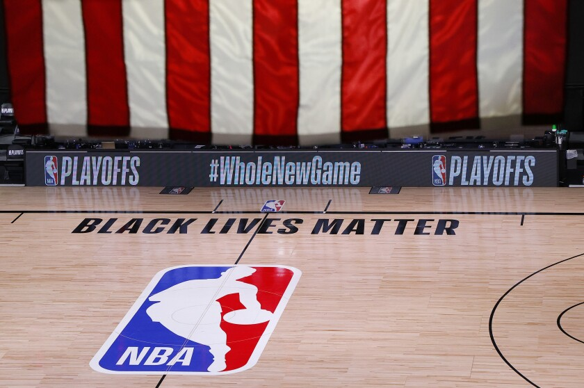 An empty court and bench are shown following the scheduled start time of an NBA playoff game Aug. 26