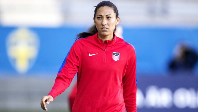Christen Press warms up for a game against Sweden earlier this week.
