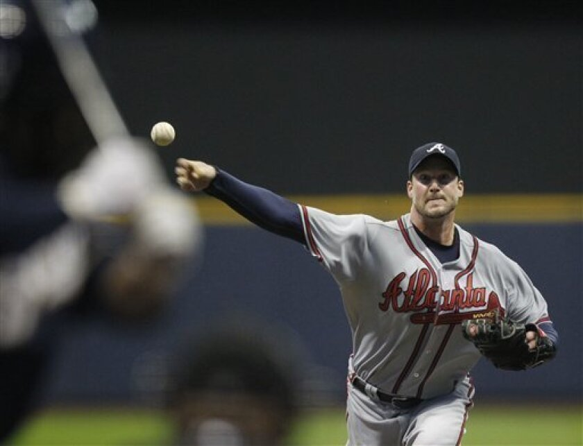 Atlanta Braves starting pitcher Derek Lowe delivers a pitch to the Milwaukee Brewers in the first inning of a major league baseball game Tuesday, April 5, 2011, in Milwaukee. (AP Photo/Jeffrey Phelps)