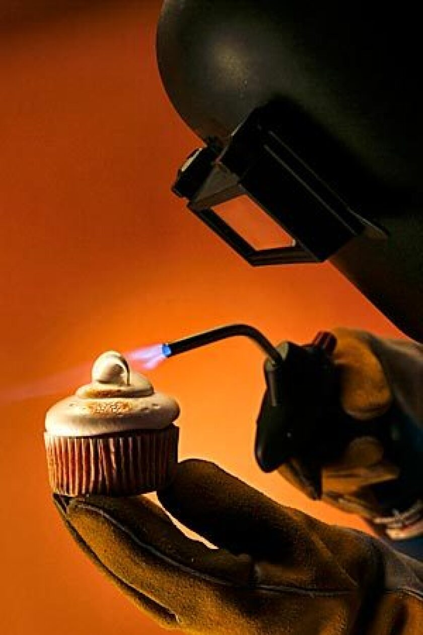 A s'more cupcake gets the final touch, courtesy of a blowtorch -- a handy tool for home cooks and chefs.