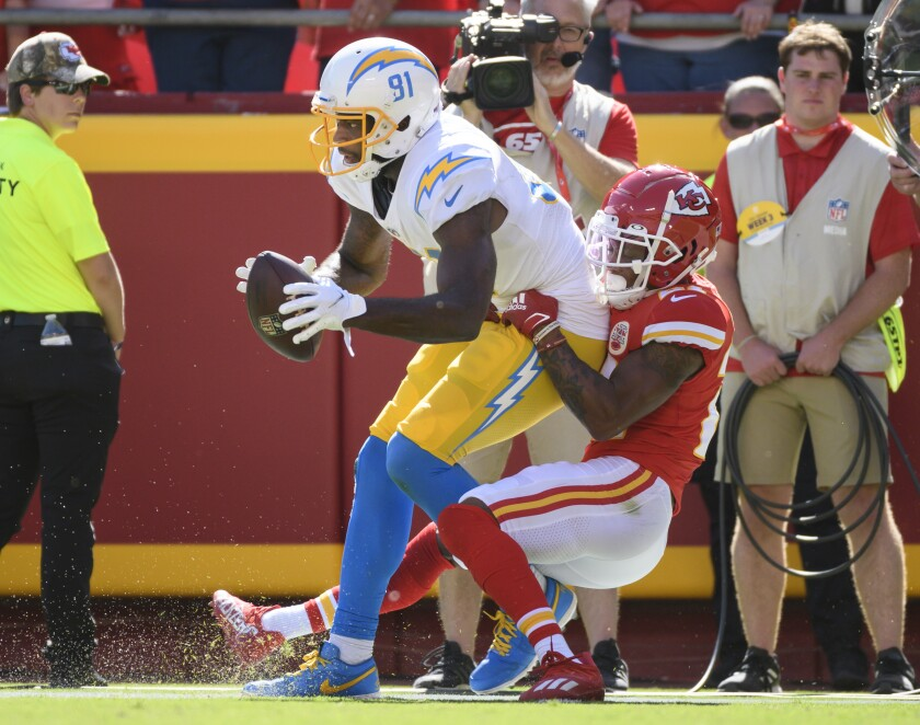 Chargers wide receiver Mike Williams (81) scores go-ahead touchdown while being tackled by Chiefs cornerback Mike Hughes.