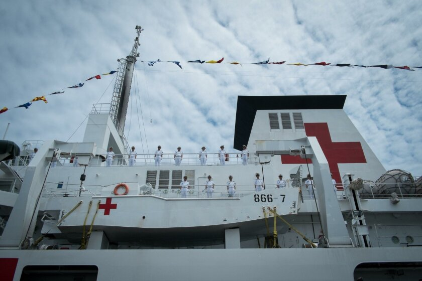 """Marines of Chinese hospital ship Peace Ark stand at attention during a welcoming ceremony at the start of the ship's stop in the port of Papeete French Polynesia, on October 23, 2015, as part of """"Mission Harmony"""", a medical assistance mission in the South Pacific island country. The Peace Ark, commissioned in 2008, is equipped with some 300 beds, eight operating rooms and over 200 types of medical devices. AFP PHOTO/GREGORY BOISSYGREGORY BOISSY/AFP/Getty Images"""