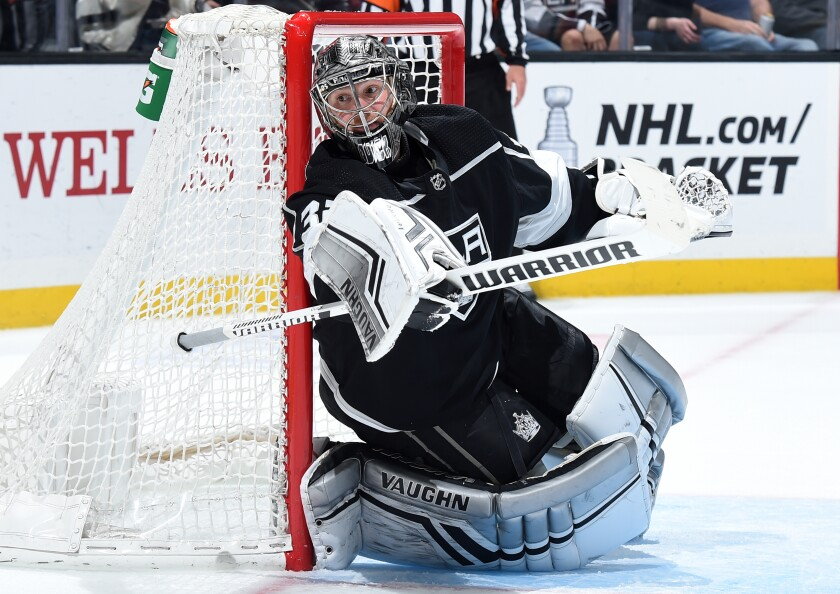 Kings goaltender Jonathan Quick keeps his eyes on the puck during a game against the Calgary Flames in April.
