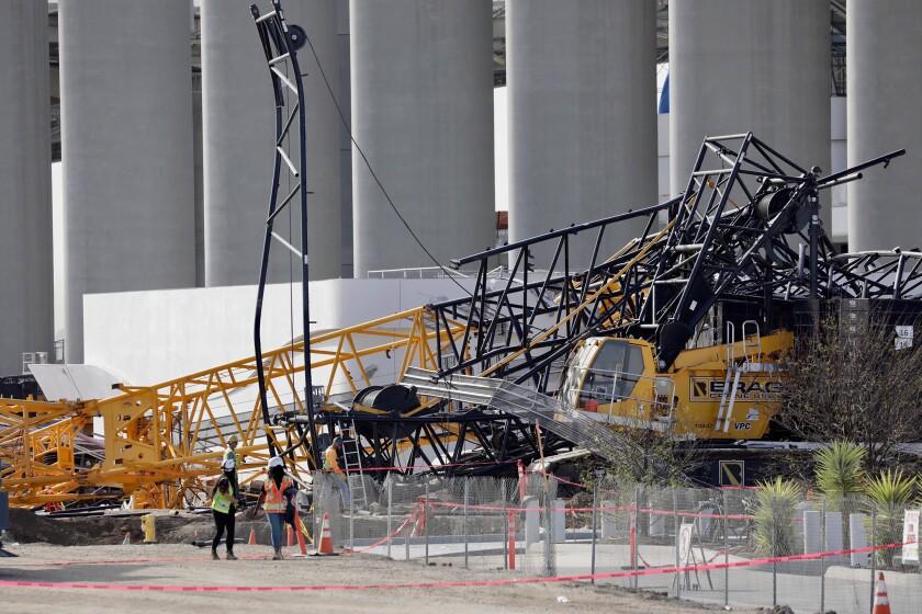 Fallen construction crane at SoFi Stadium on Friday.