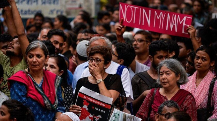 Indian protesters hold placards at a silent protest in New Delhi on June 28, 2017, in response to a