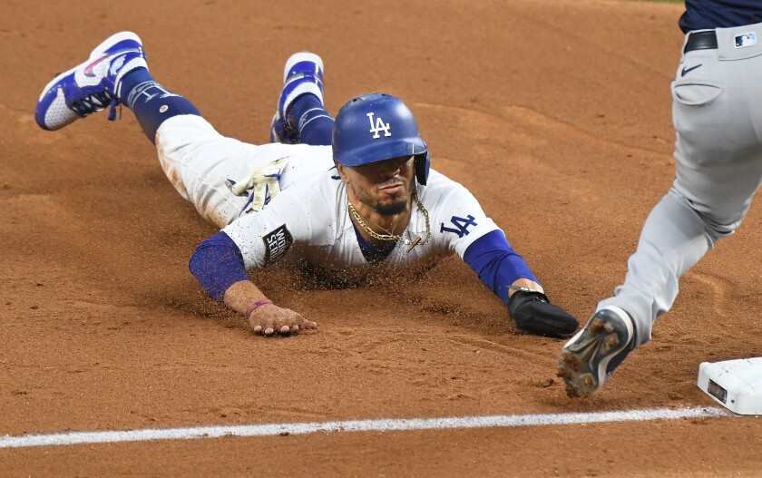 Dodgers Mookie Betts steals third base against the Tampa Bay Rays.