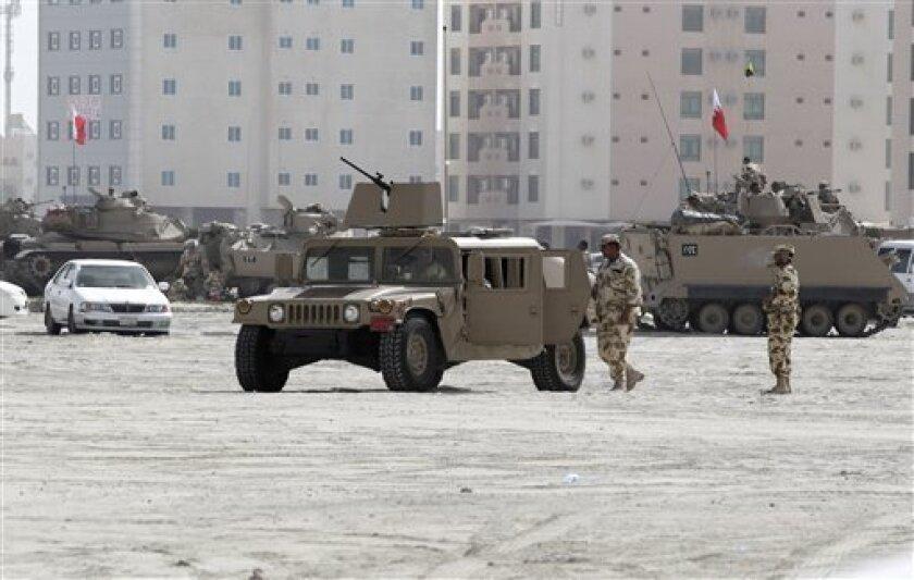 Bahraini army vehicles occupy Pearl Square, in Manama, Bahrain, Friday, Feb. 18, 2011. (AP Photo/Hassan Ammar)