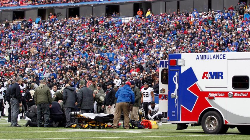 New Orleans Saints special teams player Daniel Lasco is taken off the field in a ambulance after being hurt covering a kickoff against the Buffalo Bills.
