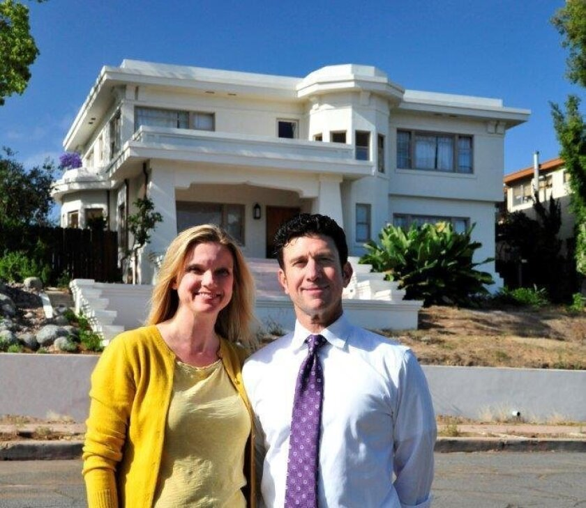 Laurie Brae and Kevin Kravets restored their Mission Hills home by bringing back the second-floor balcony, removing window bars and stone veneer and refinishing all surfaces and windows.