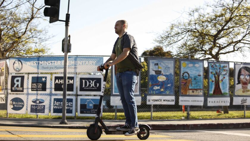 VENICE, CA -- TUESDAY, MAY 15, 2018-- A man is seen using a motorized scooter Bird through the stre