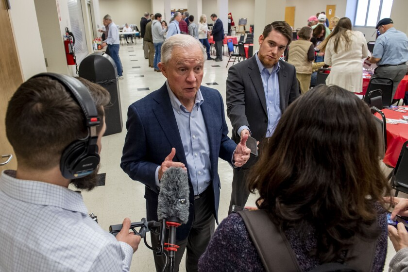 Jeff Sessions talks with the media as he campaigns at a Jefferson County GOP candidate pancake breakfast, Saturday, Feb. 29, 2020, in Birmingham, Ala. (AP Photo/Vasha Hunt)