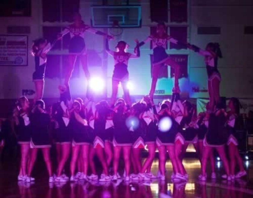 La Jolla High School Varsity and JV cheerleaders perform a stunt during the rally.