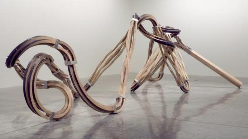 "Richard Deacon: ""Dead Leg"" (2007). Steamed oak, stainless steel. (Courtesy of the Artist and L.A. Louver, Venice, CA)"