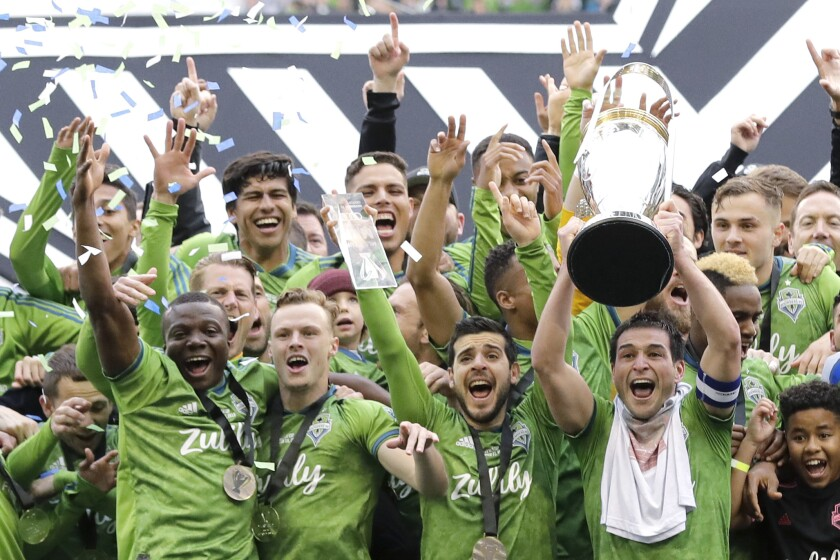 Seattle Sounders celebrate after winning the MLS Cup championship Nov. 10.