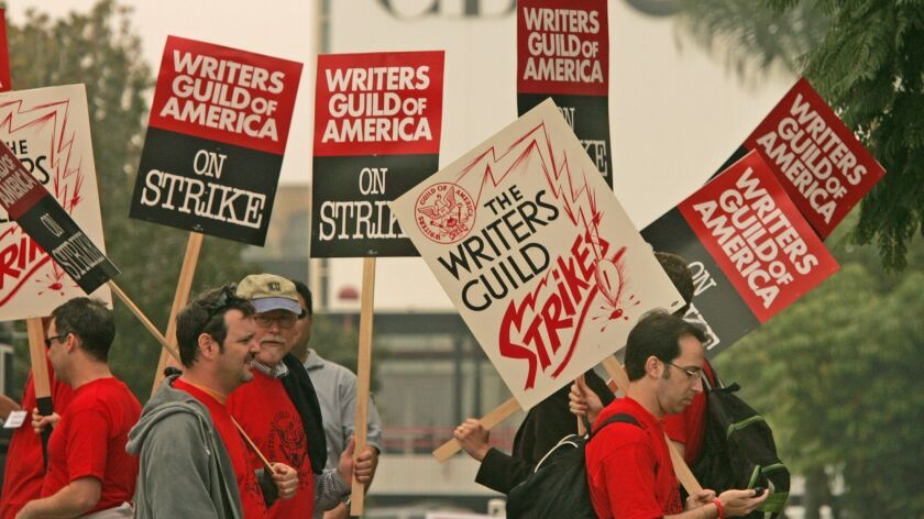 Writers Guild of America picketers march outside CBS Studios in Los Angeles in 2007.
