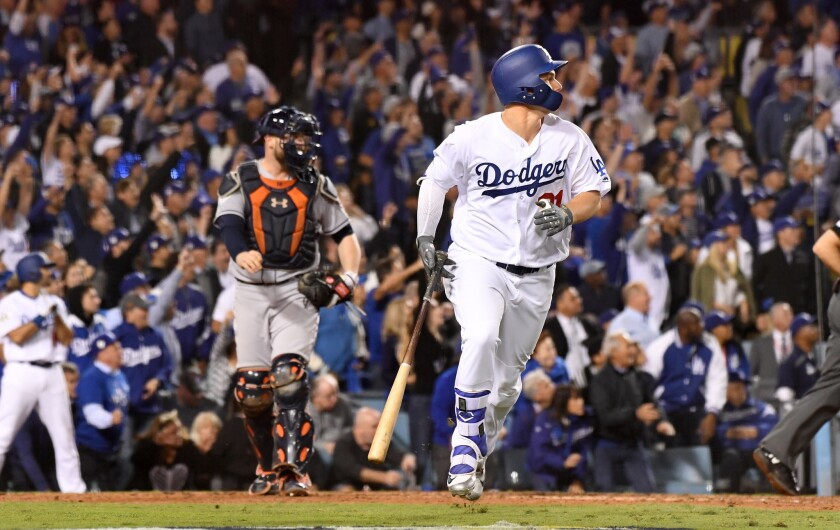 Joc Pederson hits a solo solo home run in the seventh inning against the Houston Astros in Game 6 of the World Series at Dodger Stadium on Tuesday.