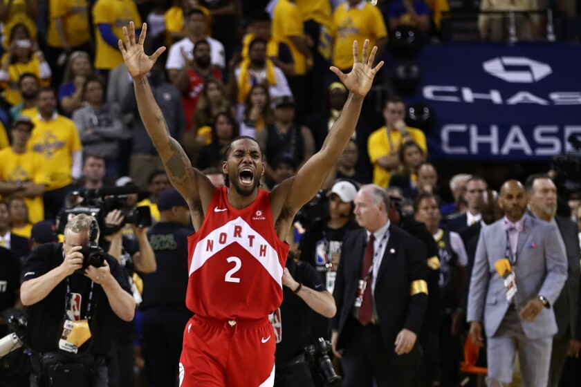 Kawhi Leonard celebrates after the Raptors beat the Warriors in Game 6 of the NBA Finals to clinch the championship.