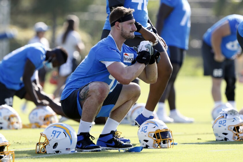 Los Angeles Chargers defensive end Joey Bosa (97) works a drill during practice at the NFL football team's training camp in Costa Mesa, Calif., Wednesday, July 28, 2021. (AP Photo/Alex Gallardo)