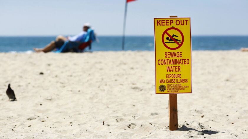 Signs barring swimming at Imperial Beach were up Monday after last week's rains flushed sewage and contaminated soil from the Tijuana River into the ocean. The beaches were declared safe for swimming by the county later in the day. K.C. Alfred • U-T
