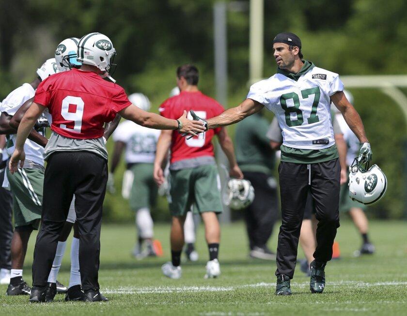 New York Jets wide receiver Eric Decker (87) greets quarterback Bryce Petty (9) during NFL football practice Wednesday, June 1, 2016, in Florham Park, N.J. (AP Photo/Mel Evans)