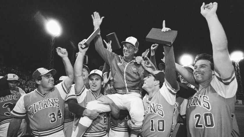 FILE - In this June 10, 1984, file photo, Cal State Fullerton Coach Augie Garrido, center, is lifted