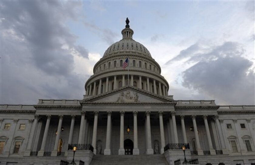 A view of the U. S. Capitol in Washington after the House voted on a deal to raise the debt ceiling, Monday, Aug. 1, 2011, after the House voted on a deal on raising the debt ceiling. (AP Photo/Susan Walsh)