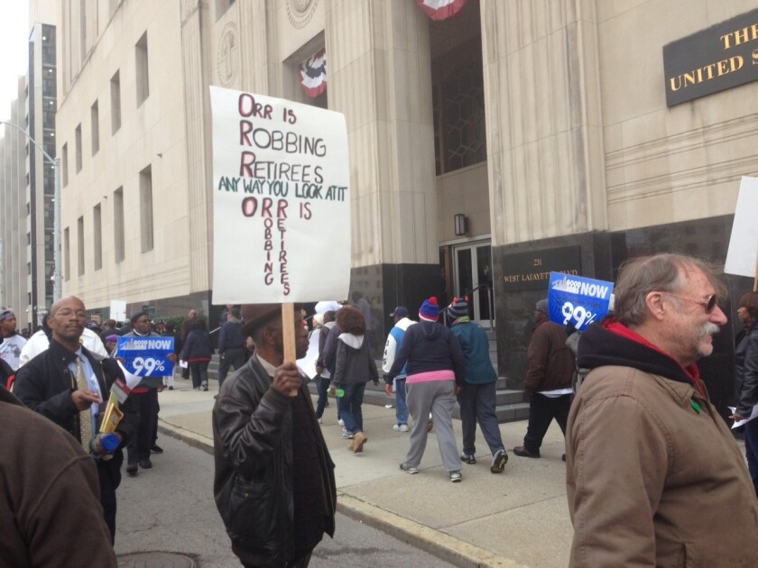 Protesters outside Detroit courthouse during bankruptcy trial
