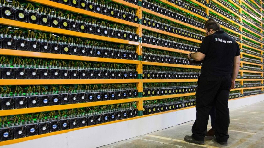 "Technicians inspect bitcoin ""mining"" in Quebec. Since the end of 2017 bitcoin has been outperformed by the euro, despite Europe's central bank printing money, and the Turkish lira, despite that country's central bank being forced to keep interest rates inappropriately low."