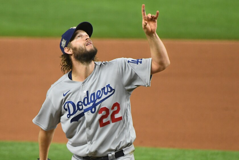 Clayton Kershaw points to a pop fly during the sixth inning in Game 5 of the World Series.