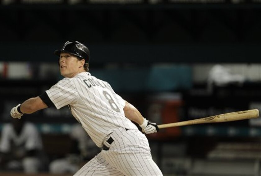 Florida Marlins' Chris Coghlan (8) watches as he hits a ground-rule double in the seventh inning during a baseball game against the Milwaukee Brewers in Miami, Tuesday, June 1, 2010. The Marlins won 6-4. (AP Photo/Lynne Sladky)
