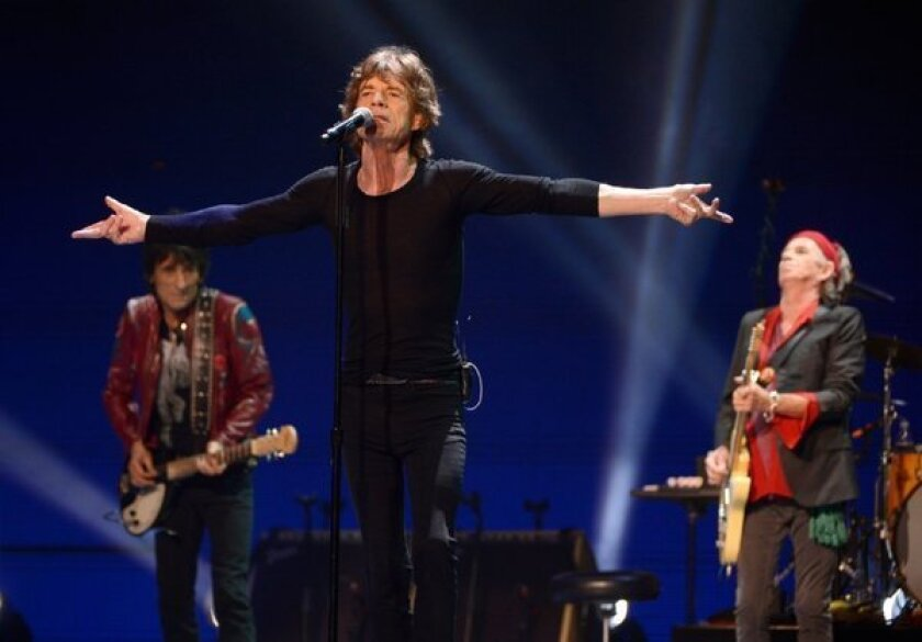 The Rolling Stones -- from left, Ron Wood, Mick Jagger and Keith Richards -- perform during the final U.S. stop on the group's 50 and Counting Tour in Washington.