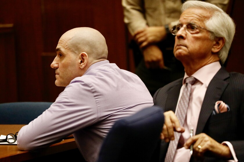 Michael Garguilo listens with his attorney Daniel Nardoni as guilty verdicts are read in a downtown Los Angeles courtroom.
