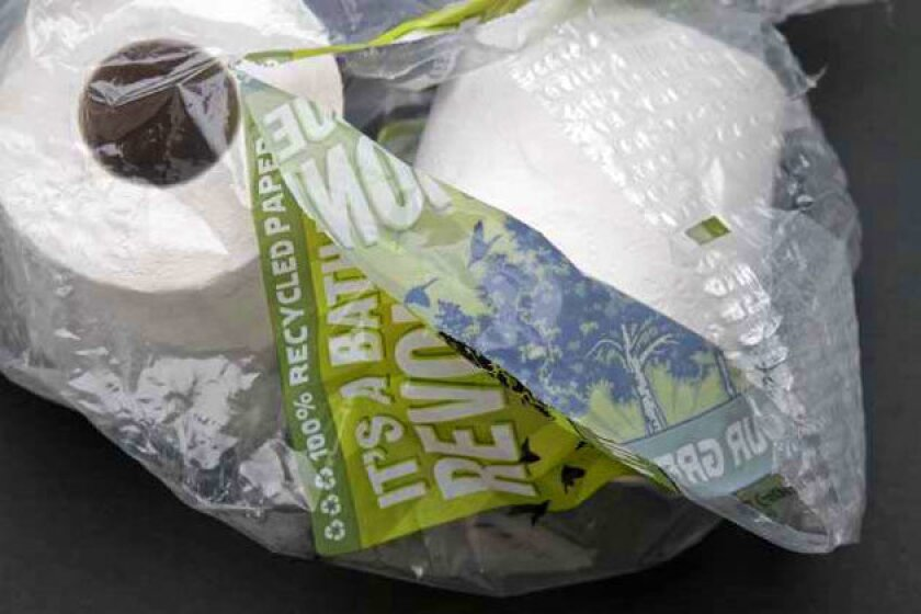 Plastic wrap around rolls of toilet paper and paper towels