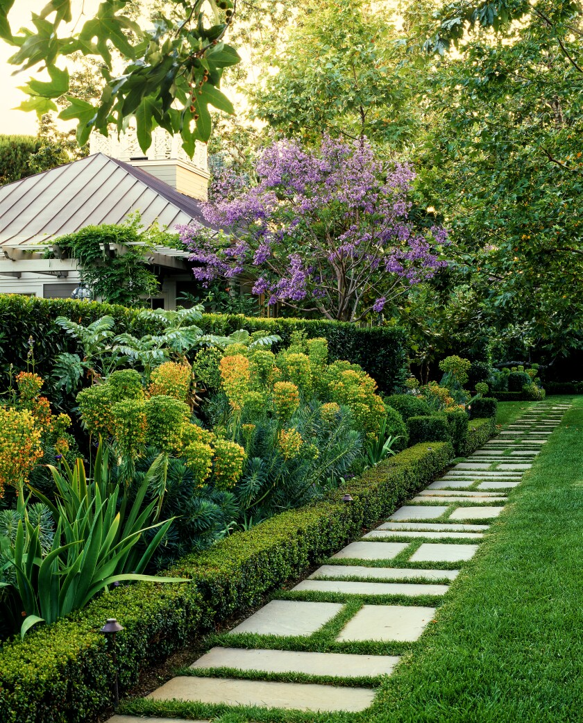 Lush gardens that surround the home were designed by Nancy Goslee Power.