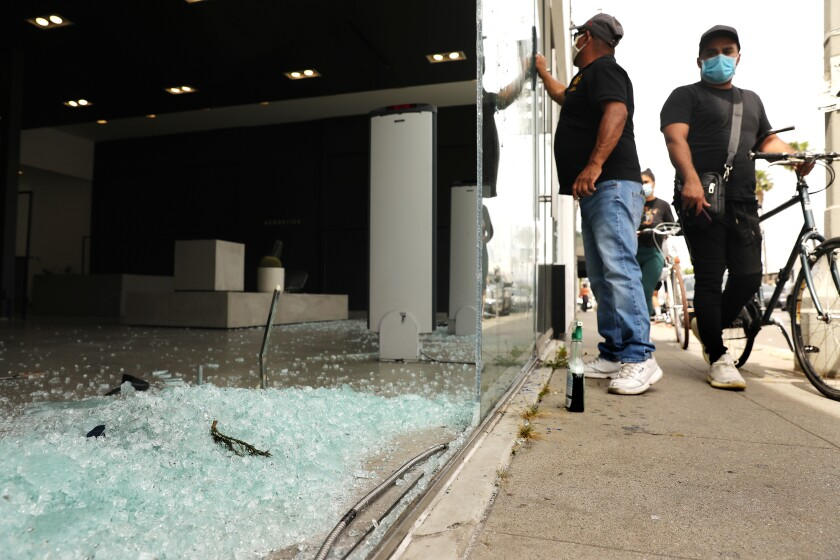 Shattered glass in front of a store