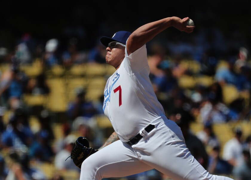 Dodgers starter Julio Urias delivers during Sunday's victory over the San Francisco Giants.