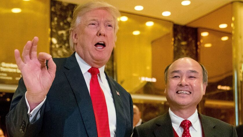 President-elect Donald Trump and SoftBank CEO Masayoshi Son make their announcement at Trump Tower in New York on Dec. 6.