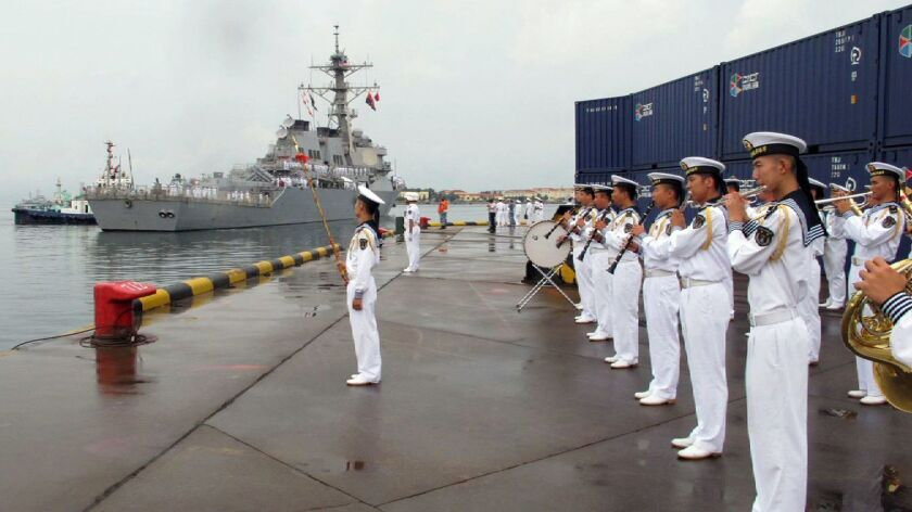 In this Aug. 8, 2016, photo, a military band plays as the U.S. guided-missile destroyer Benfold arrives in port in Qingdao, China. This weekend the ship passed through the Taiwan Strait.