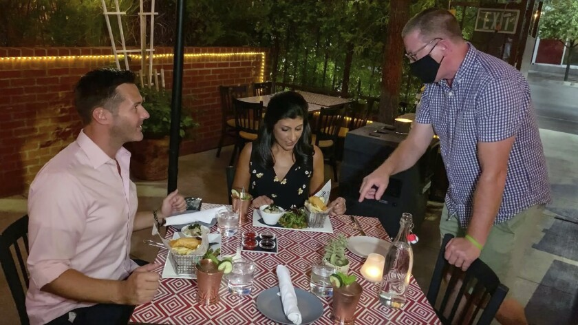 Owner Liam Dwyer, right, welcomes guests at 7th & Carson, a downtown Las Vegas restaurant