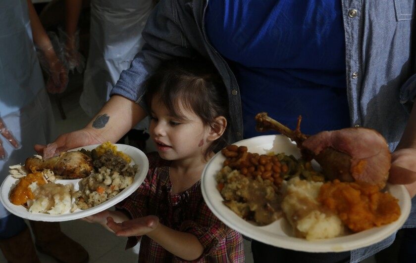 Tanya Le Flore, 36, with daughter Olia Le Flore, 2, of Long Beach at the United American Indian Involvement meal.